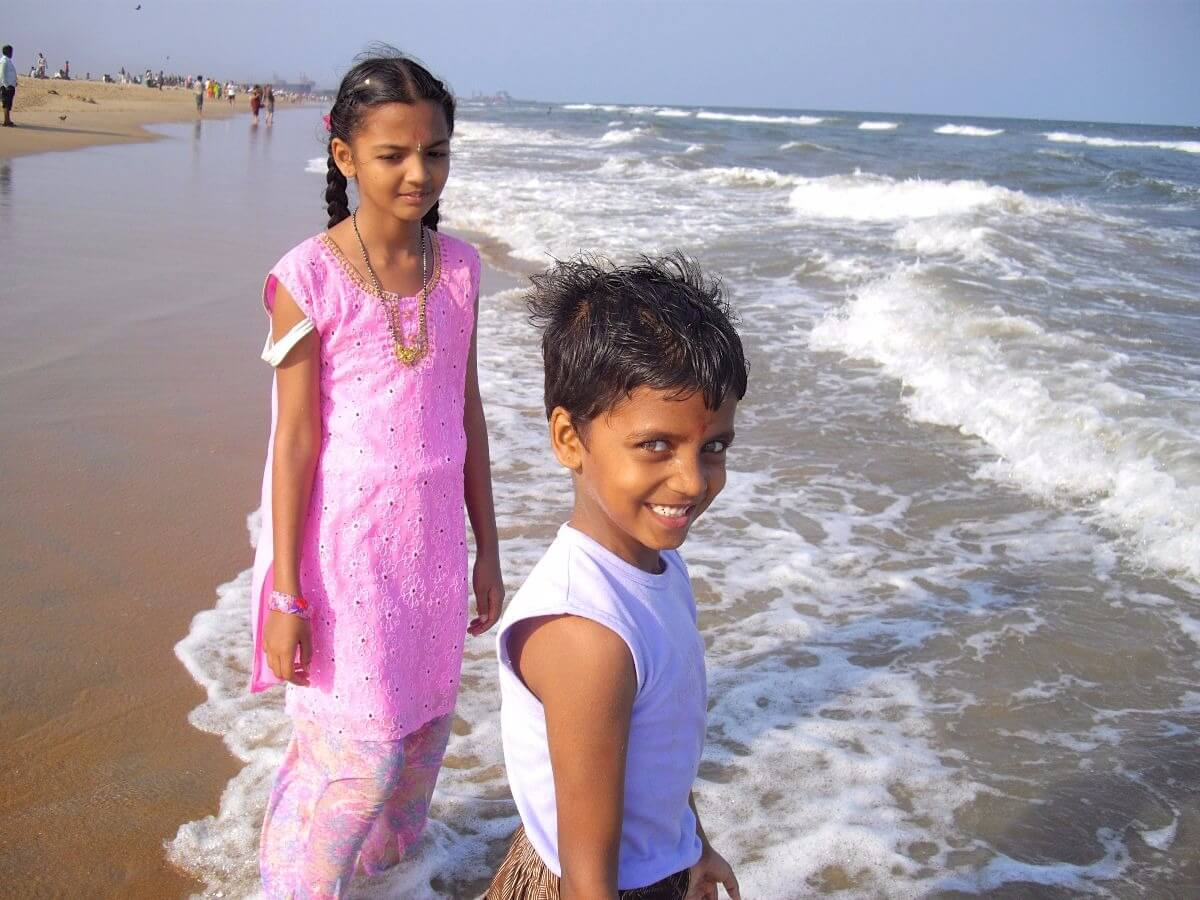 Two kids on the beach of Madras Tamil Nadu