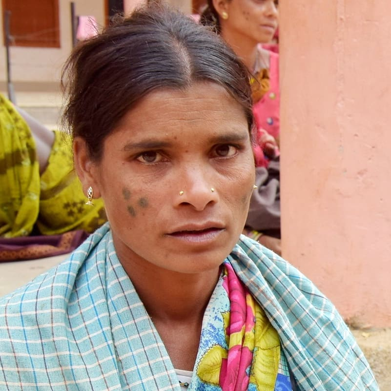A woman from the Hill Maria Tribal group of Chhattisgarh in India, with a tattoo on her face