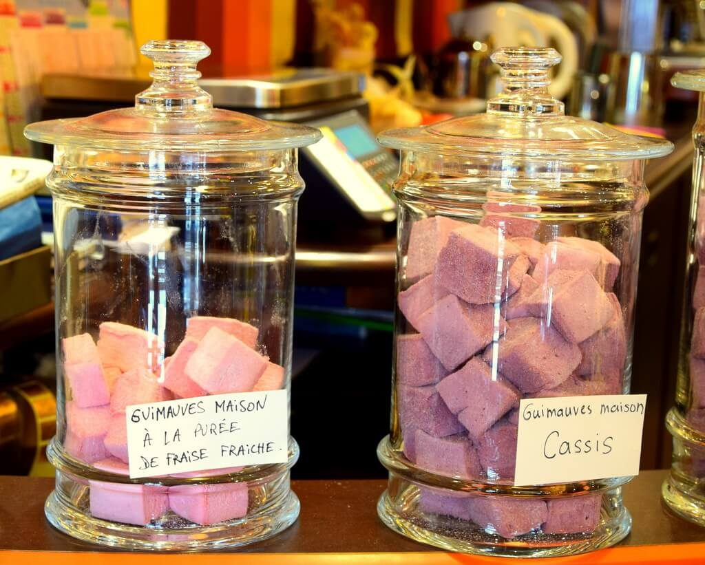 Two glass flasks with marshmallow made from fresh fruits in a chocolaterie in Bayonne