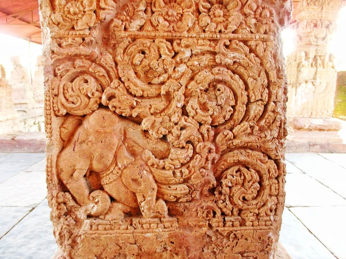 A pillar carved with a animal mixed of elephant and peacock