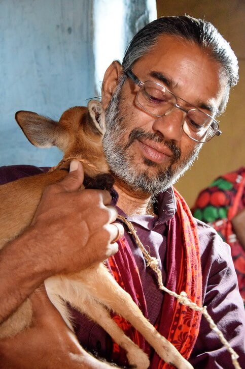 Shakeel with the barking deer putting his head for a hug as a thank you for his care