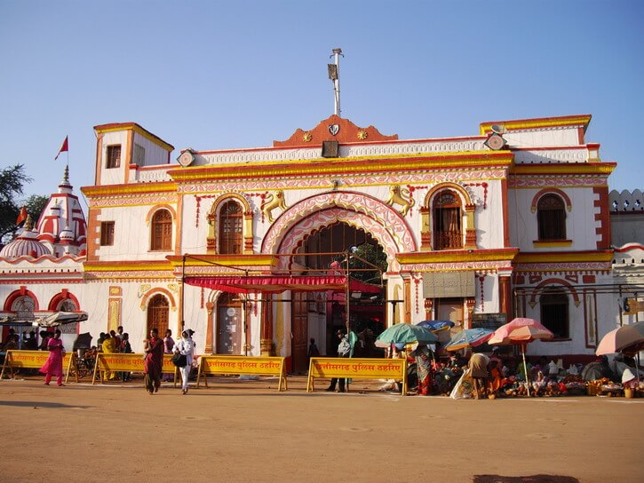 The white and orange gate of Bastar palace and the white and red dome of Danteswari temple Jagdalpur