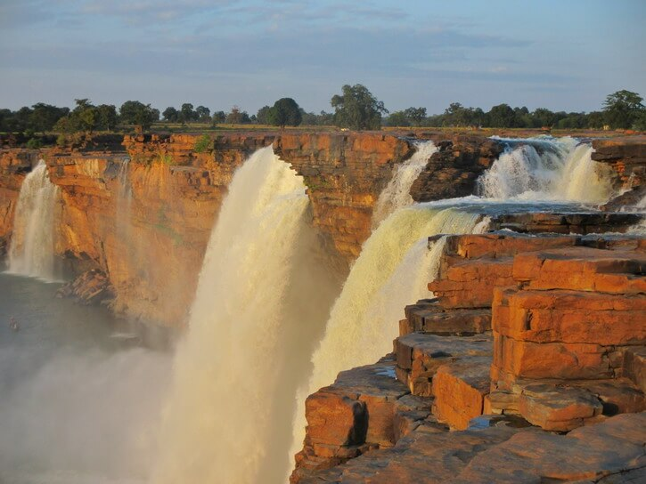 Chitrakoot Chhattisgarh falls with a beautiful orange color because of the sunset