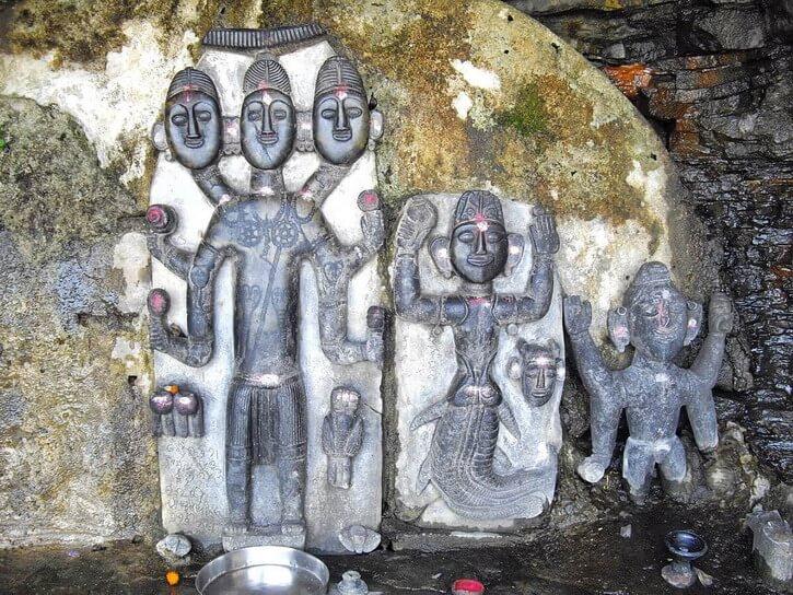 Tribal Gods carved on stones