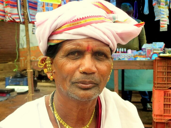 Tribal man from Jagdalpur Chhattisgarh wearing a white and orange turban and Tribal jewels