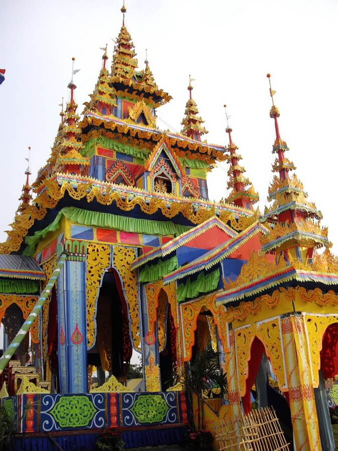 Life size temple in yellow, blue and orange wallpaper in which the cremation will take place