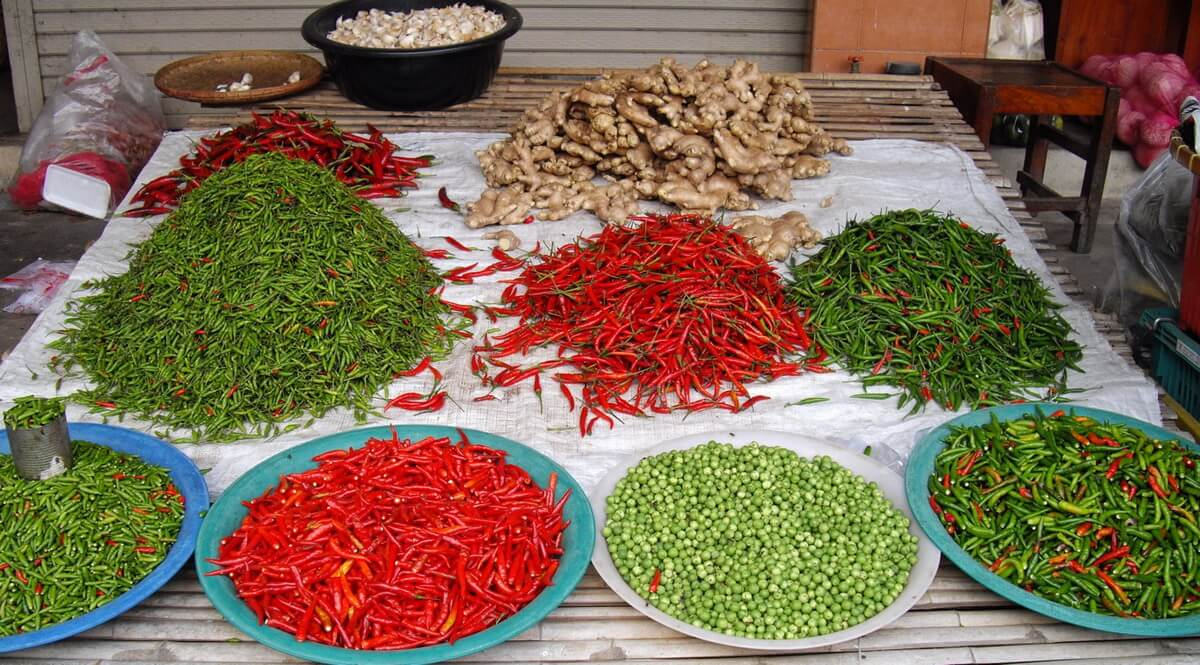 Green and red chilli, green peas and ginger on a beautiful market stall