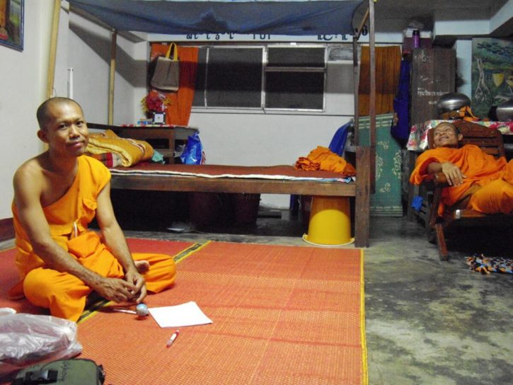 The Burmese monk Nyne Chang on the ground and his friend Pyna Wan Tha on a chair in Nyne Chang's monk cell