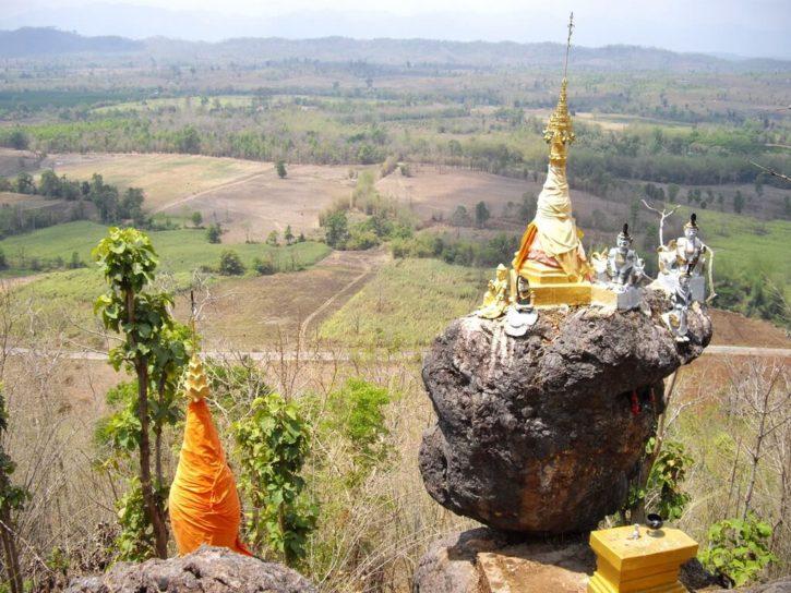 A pagoda perched on a balancing rock