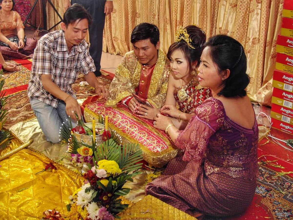 The groom, bride, Kak and his mother during the wedding rituals