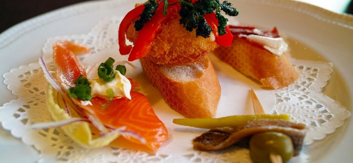 Tapas made from bread, croquettes, salmon, vegetables...