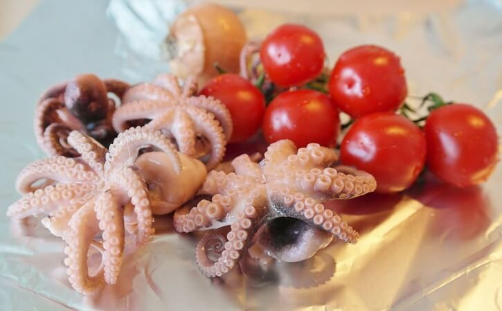 Cleaned squids with cherry tomatoes