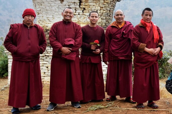 The Nyingmapa Buddhism group of Lamas posing in front of an old stûpa