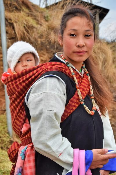 A beautiful young Monpa girl with her baby