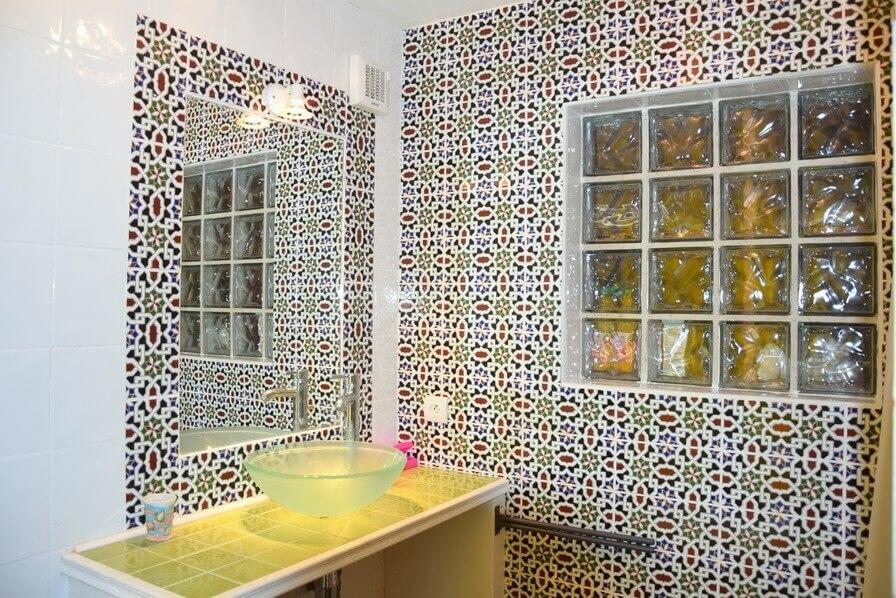 the mauresque style bathroom with an italian shower