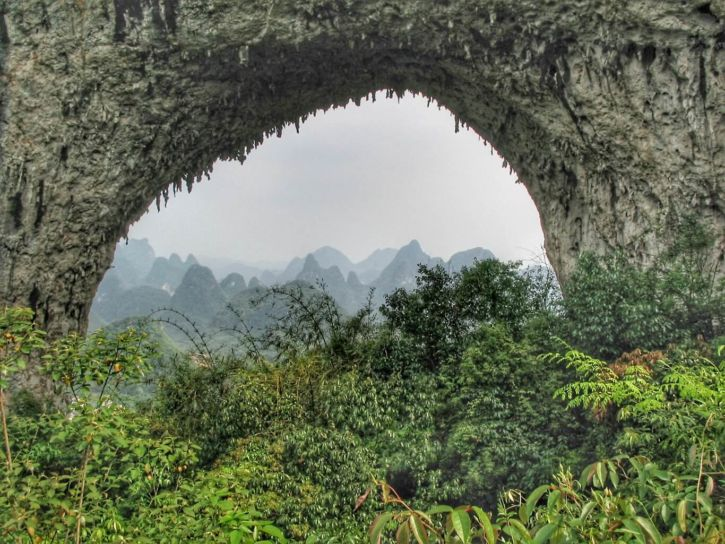 The arch of Moon Hill with the view of the karst peaks