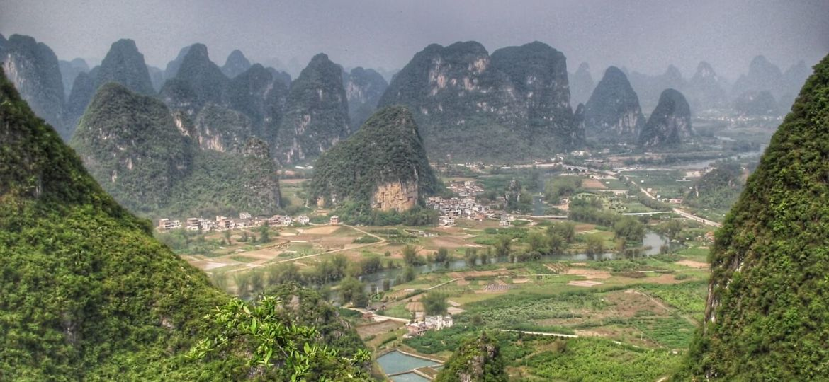 Karst peaks of Yangshuo county and Li River from Moon Hill