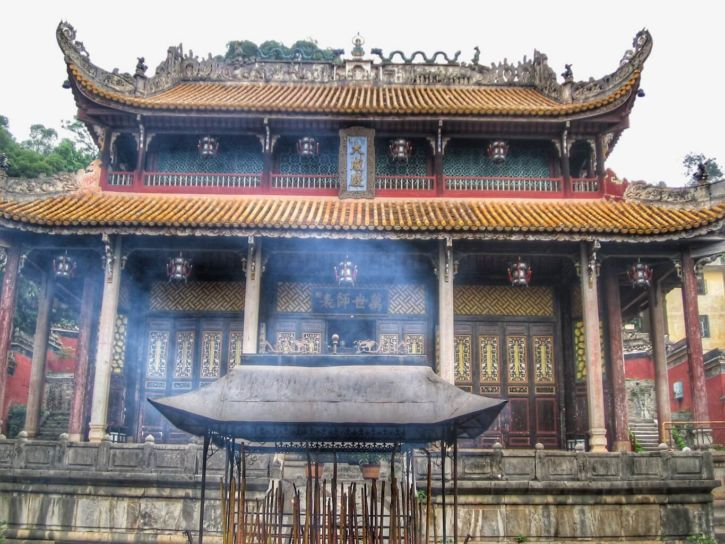 A building of the temple with incense sticks