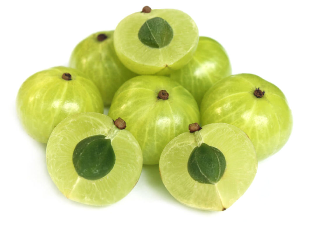 Amla fruit or Indian gooseberry cut into two pieces