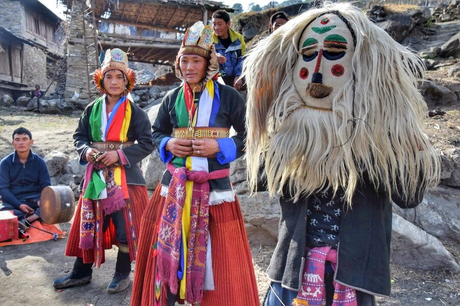 Monpas dancers in traditional Cham dance attire