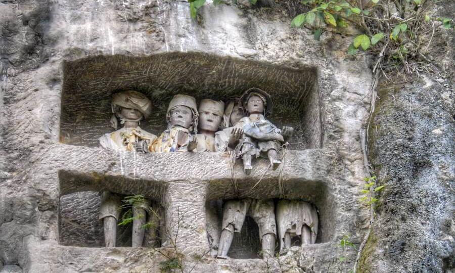Torajan Tau Tau in the cliff of Suaya close to Rantepao