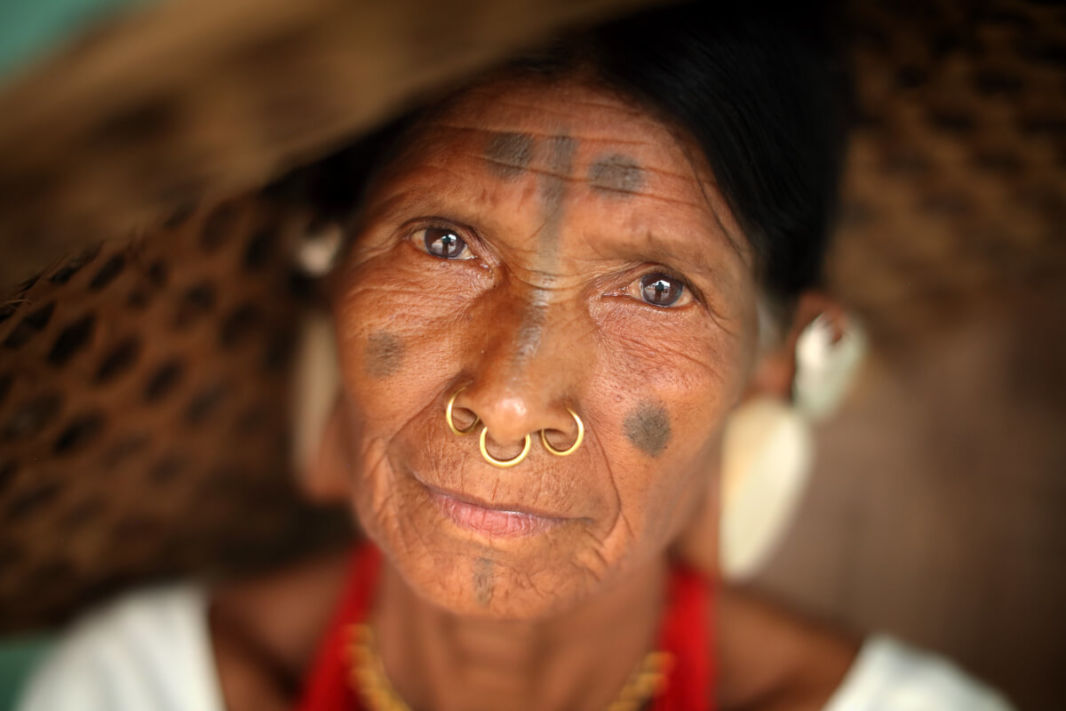 Face of a Sora Tribal woman with her facial ornaments and tattoo