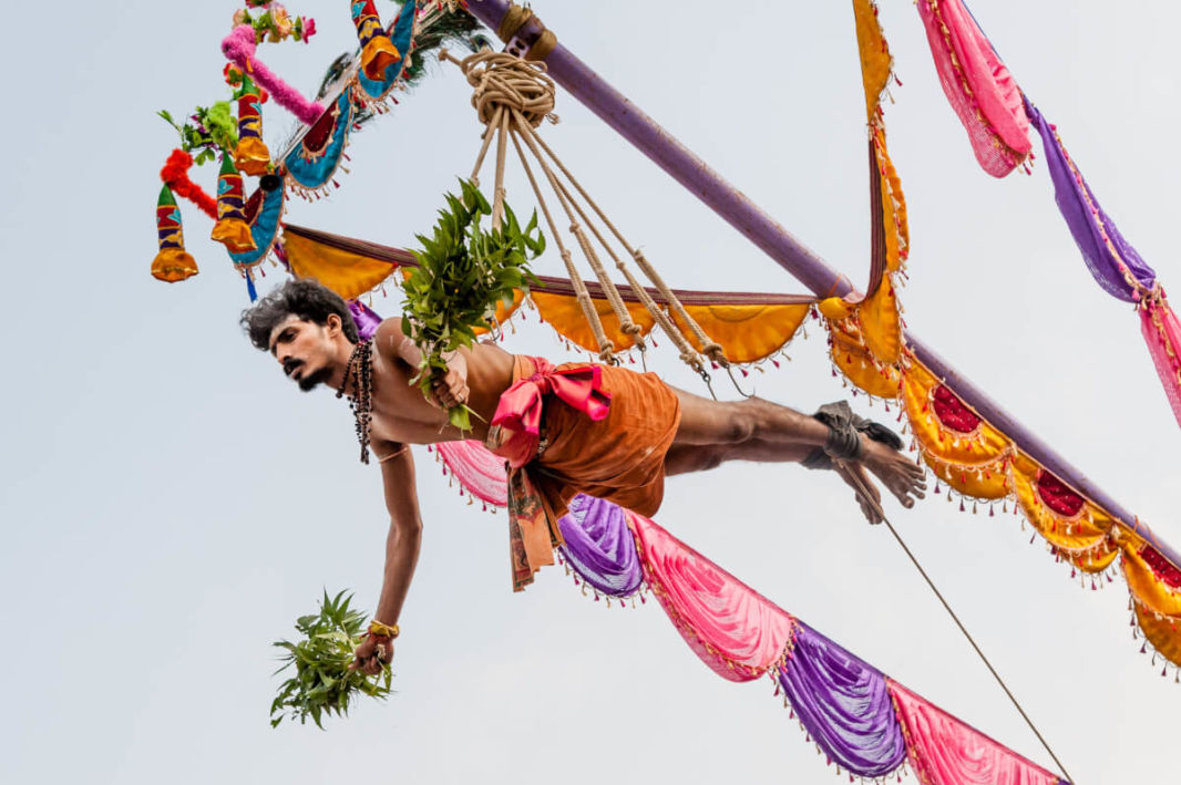 Devotee hung on a swing for Thaipusam