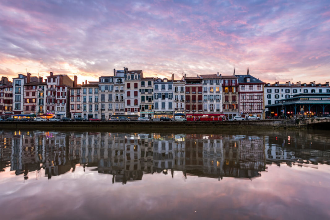 Bayonne quays with the colouful houses reflected in the river