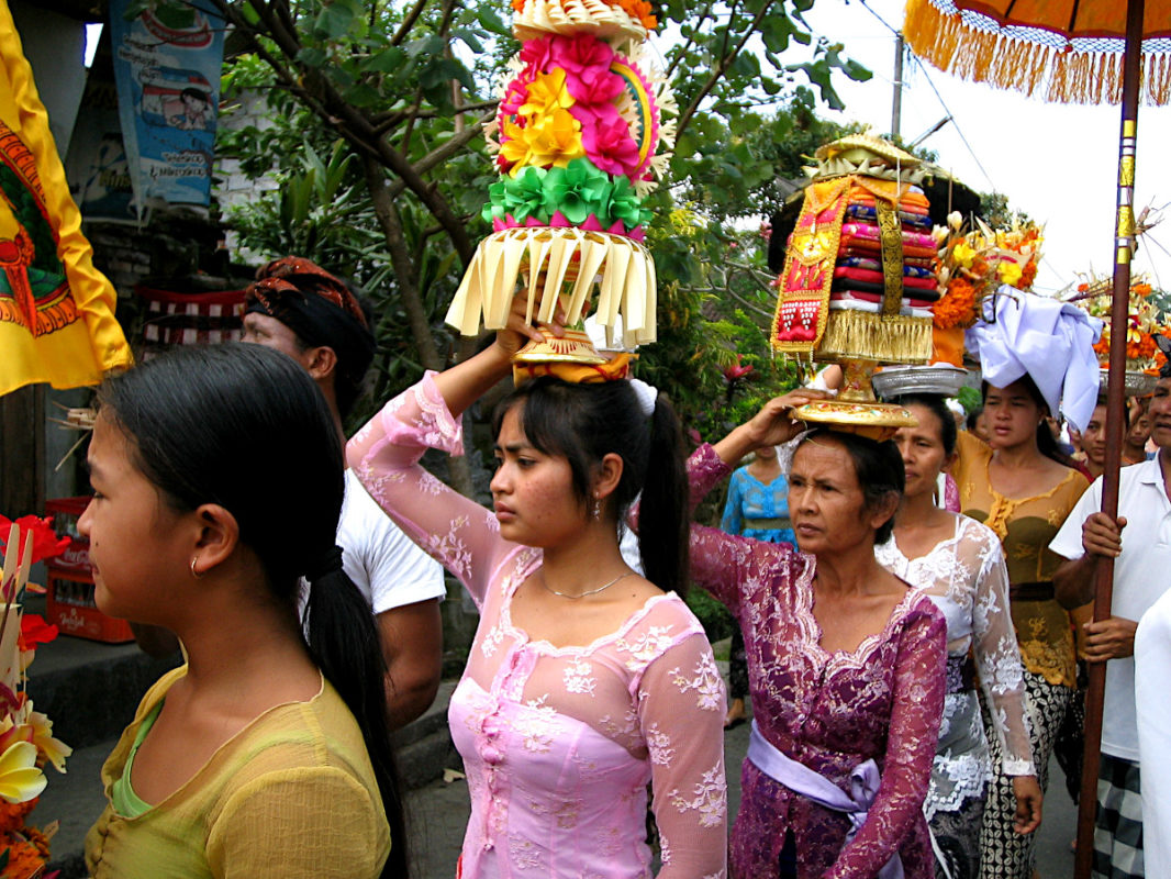 Colorful offerings carried on the head of Balinese women