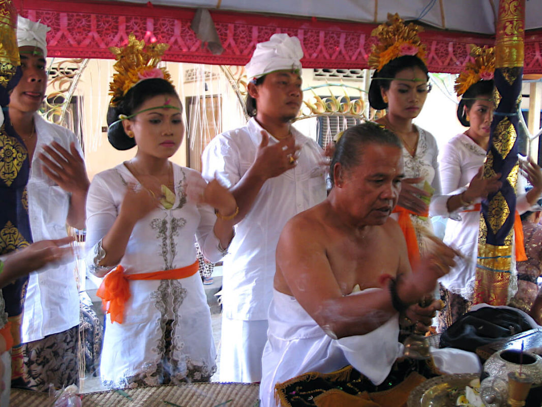 Balinese Brahmin and youths during the big birthday ceremony