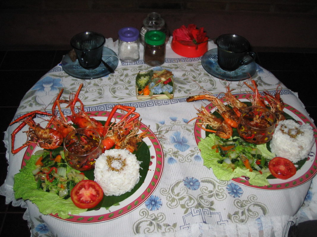 2 plates with crawfish, rice and salad