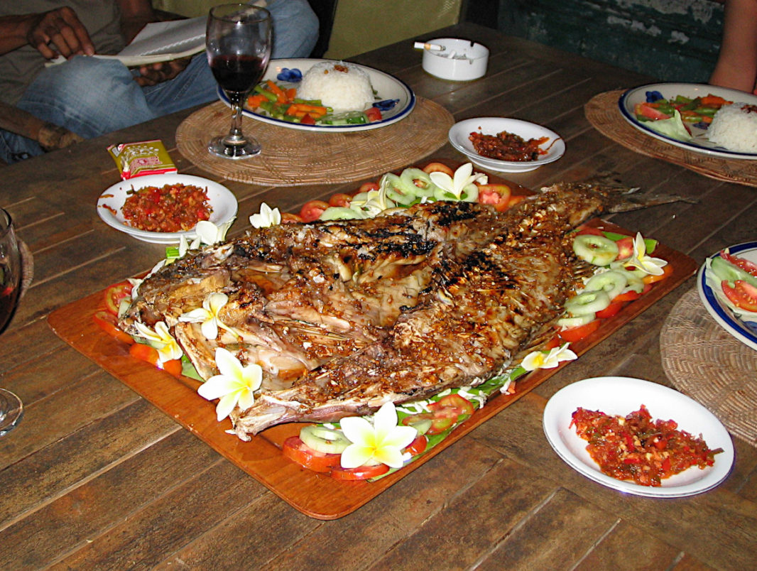 A big cooked Balinese fish decorated with franginpani flowers