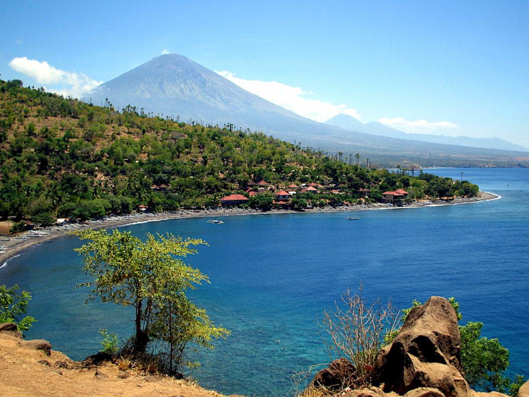Batur volcano overlooking Amed jungle, beach and Bali sea