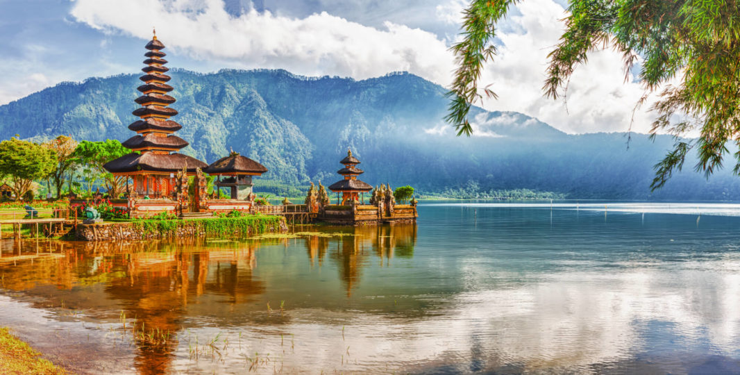 Balinese temple surrounded by the mountains and in the middle of Bratan lake